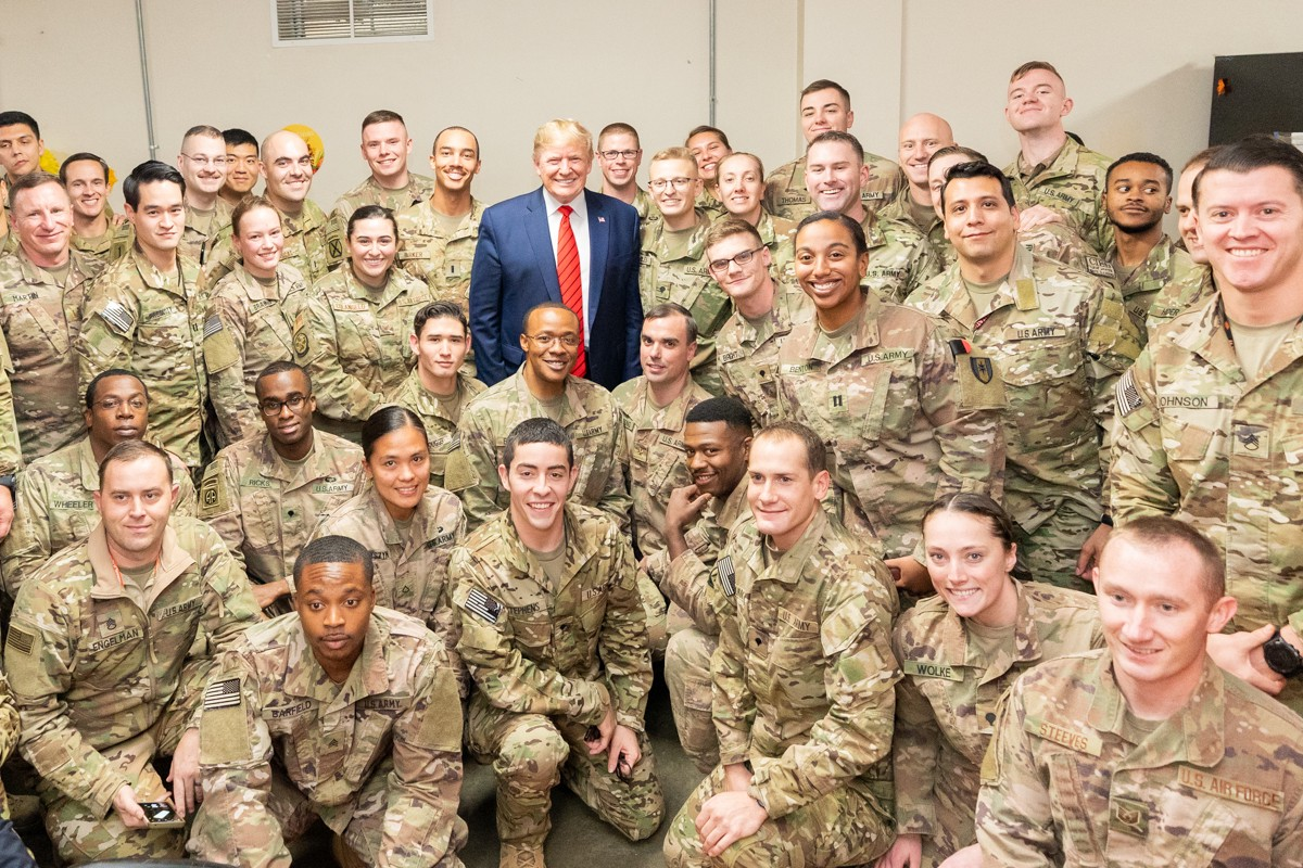 poses with troops