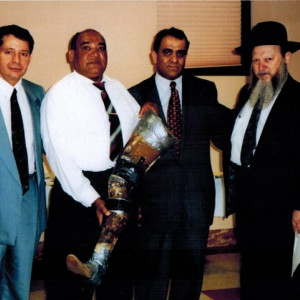 presenting prosthetic leg to julio mendoza at rabbinical college of america